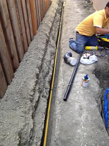 irrigation contractor in Delray Beach lays PVC pipe for a new installation